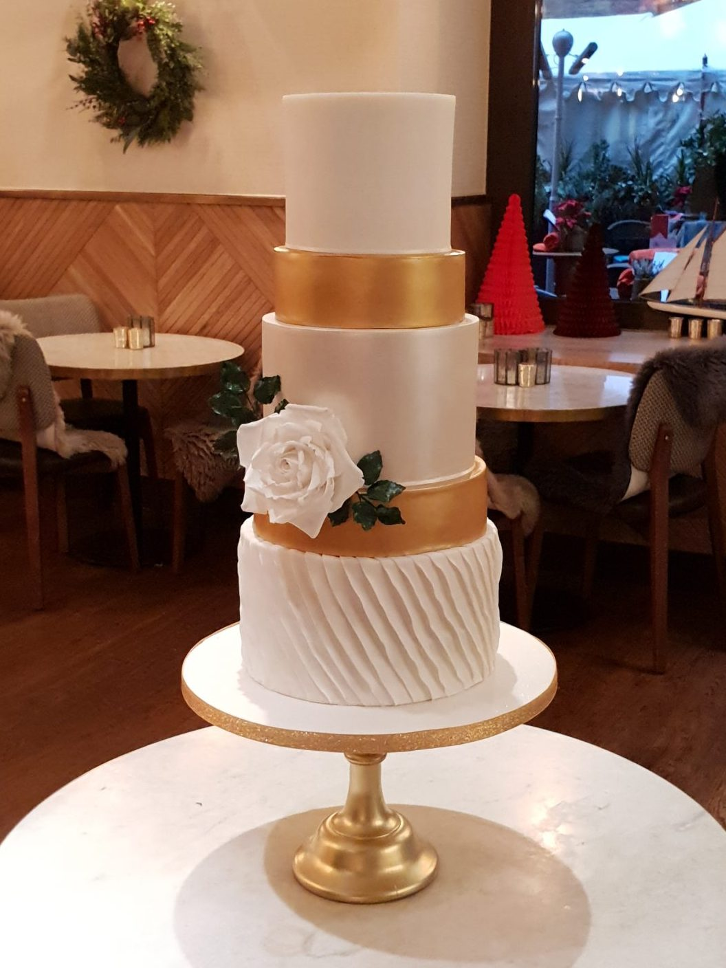 Gold white winter christmas wedding cake white ruffles white sugar rose