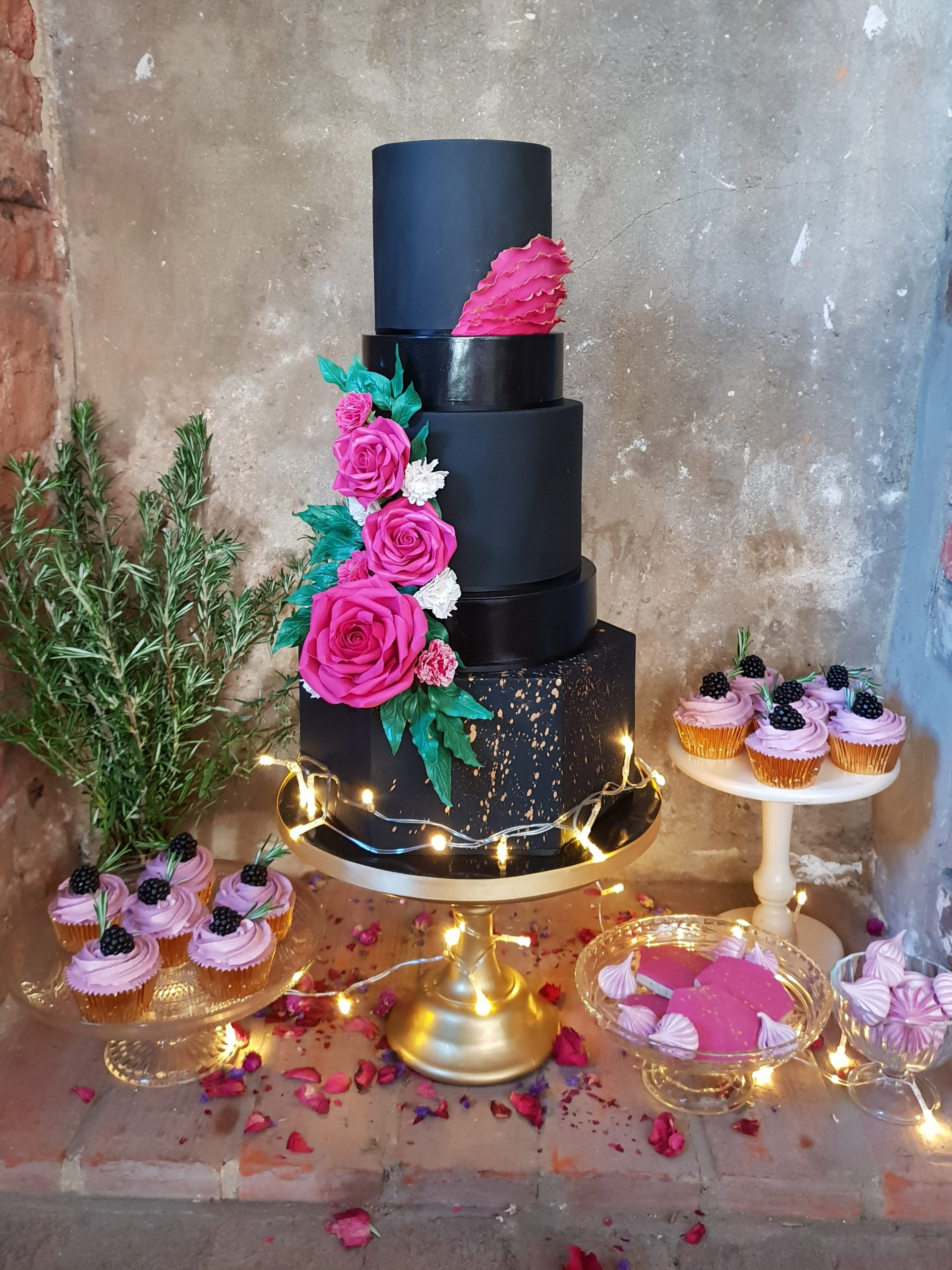 Black wedding cake hexagon tier gold paint splash alternative wedding cake modern fairy lights gold wedding cake essex