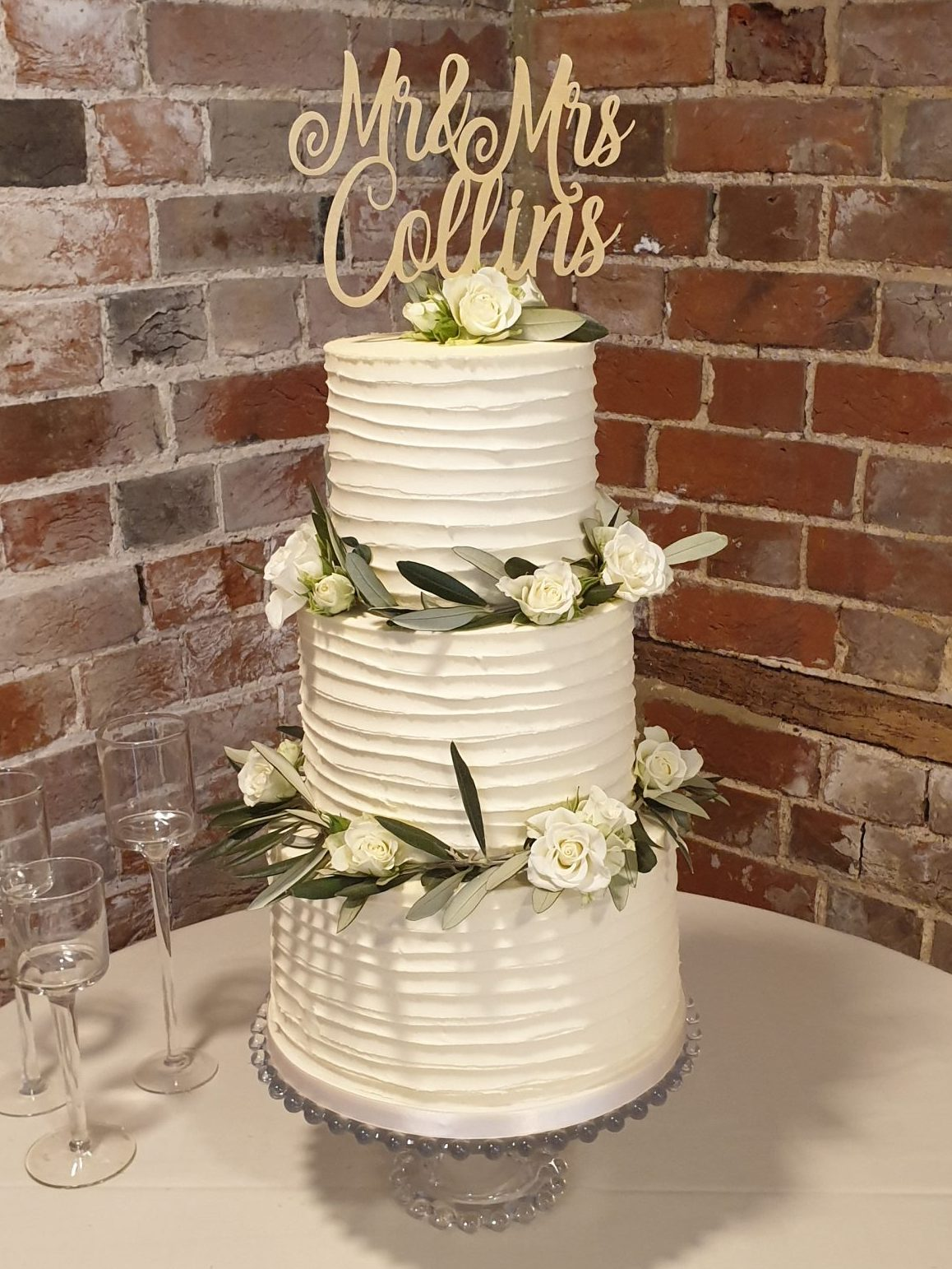 Ridged Buttercream Wedding Cake Olive Branches white roses wreath Gaynes Park Essex Wedding Cake