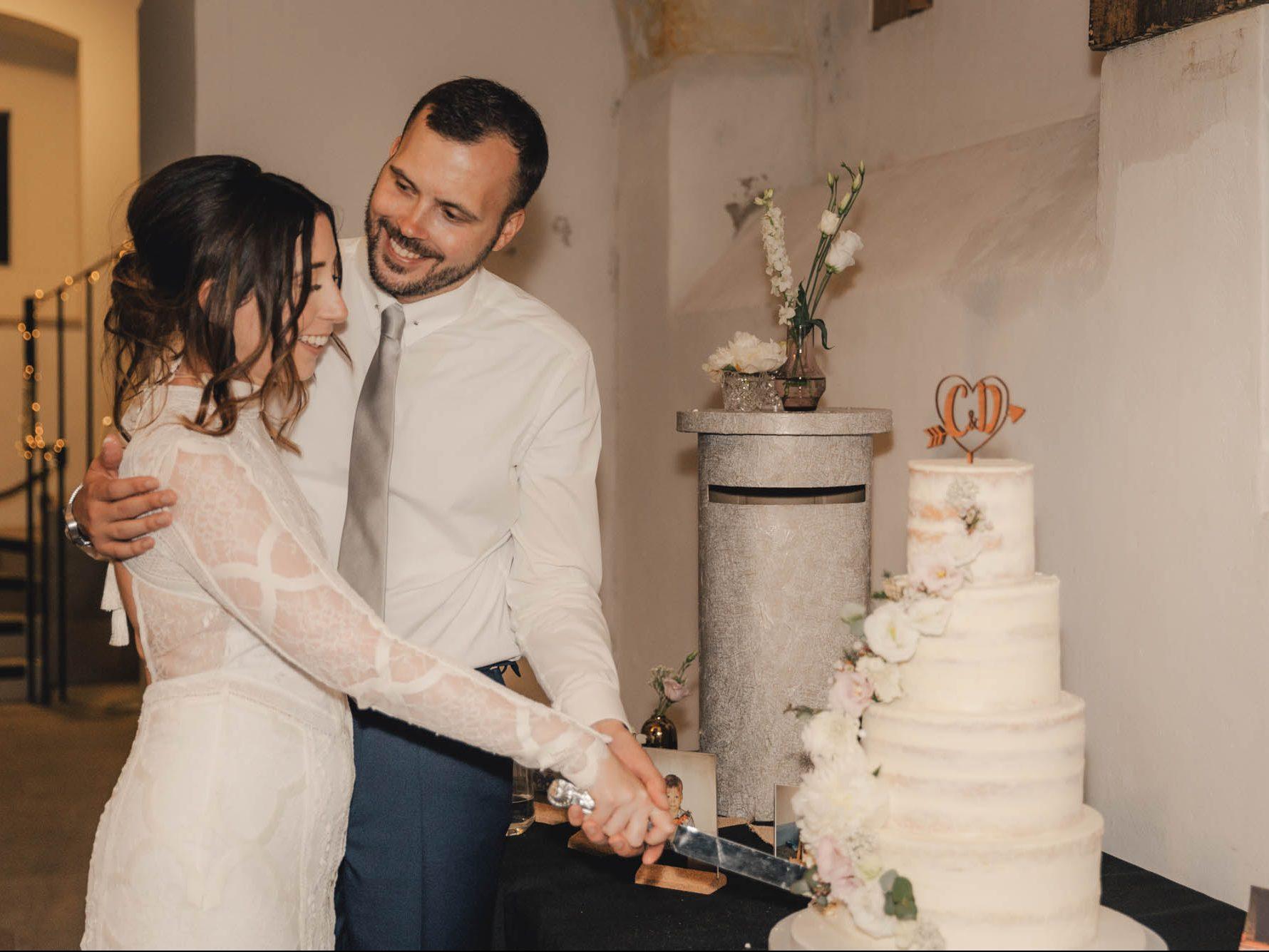 Cutting the cake semi naked wedding cake london wedding