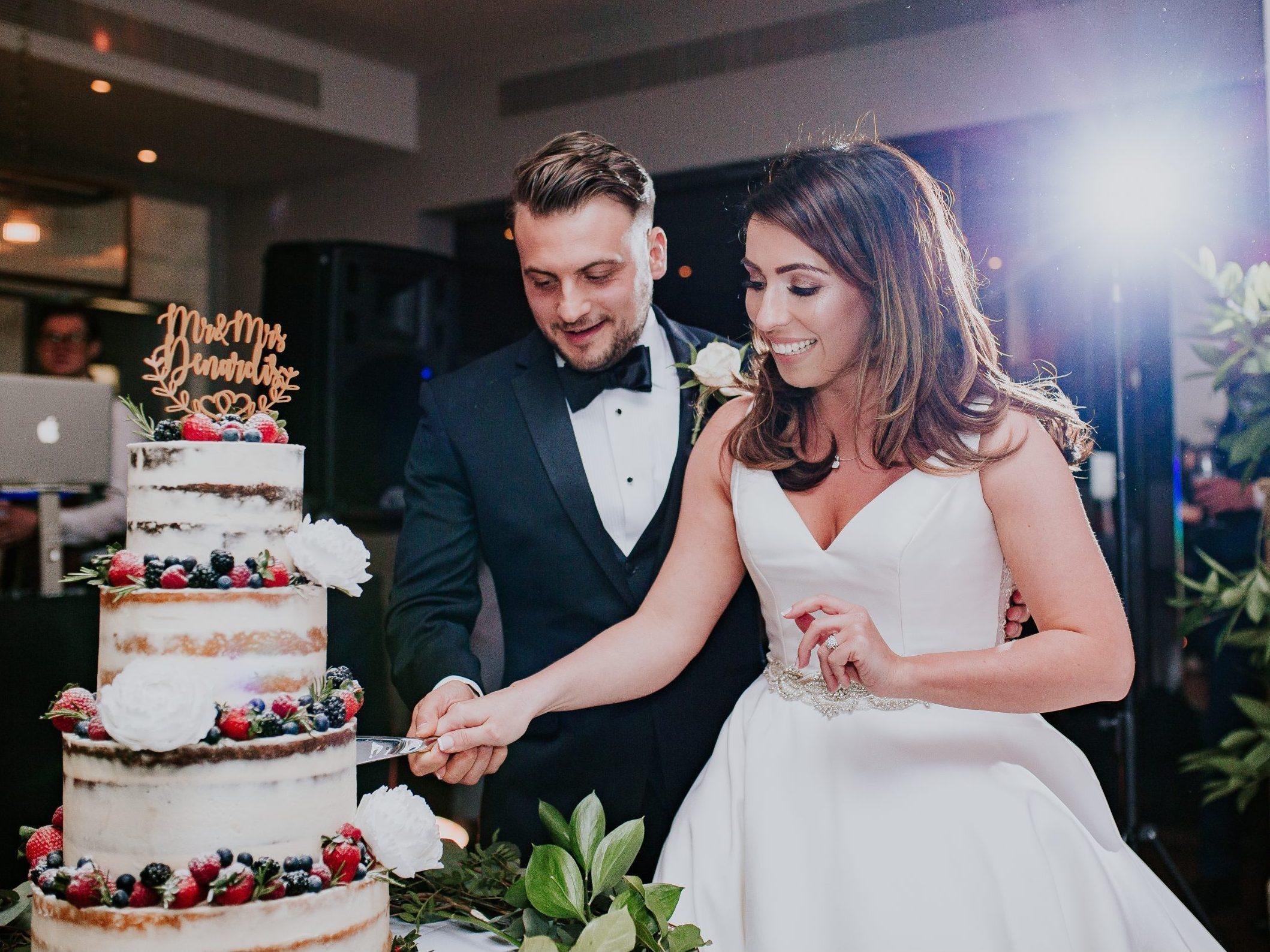 cutting the wedding cake semi nake wedding cake fresh fruit devonshire terrace london wedding cake