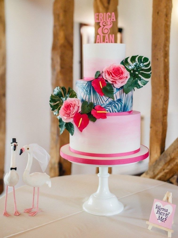 tropical wedding cake pink sugar flowers monstera leaves palm tree wedding cake