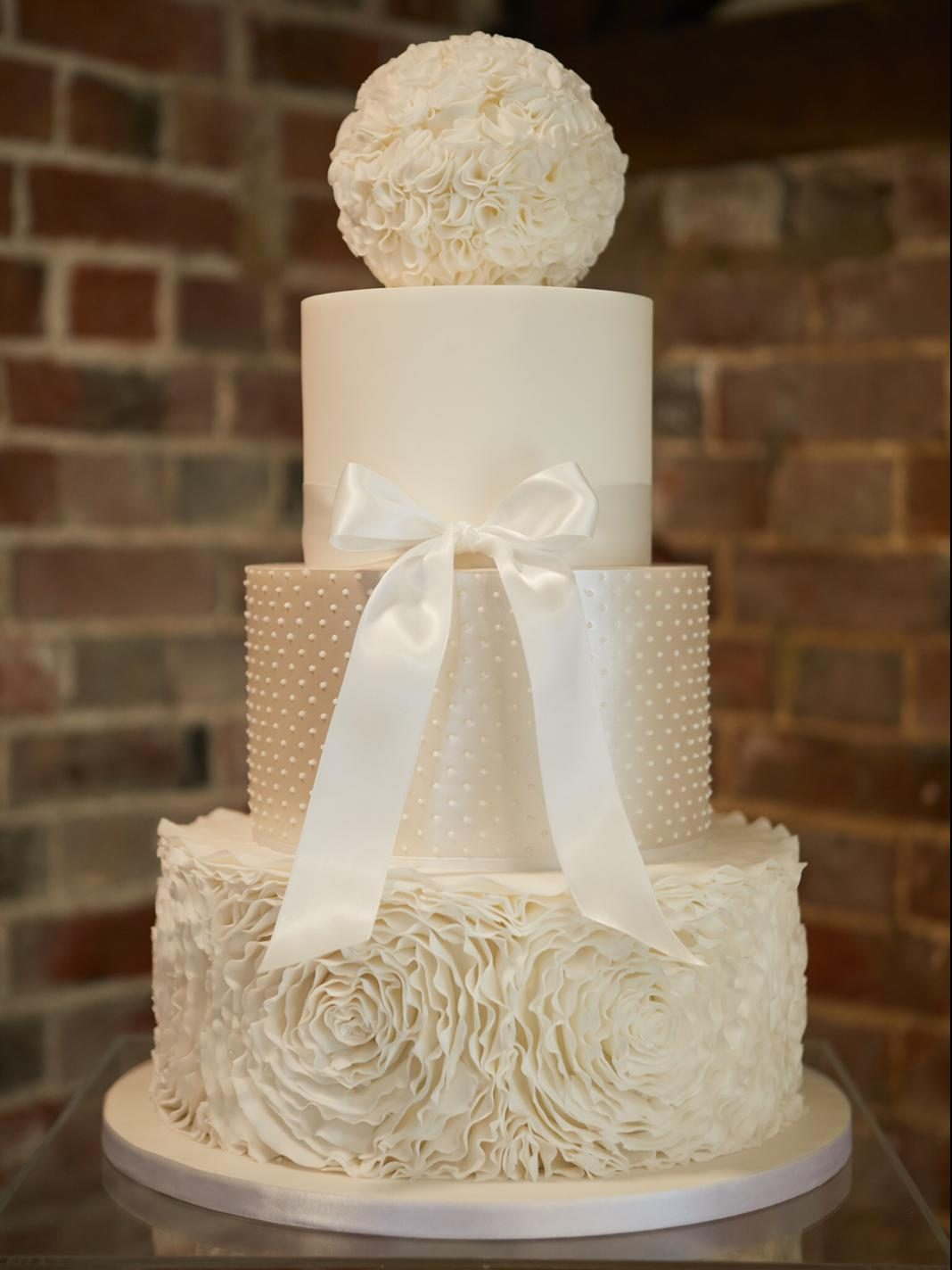 All white wedding cake white ruffles, pearl lustre shimmer, ruffle ball topper, essex wedding cake Gaynes Park