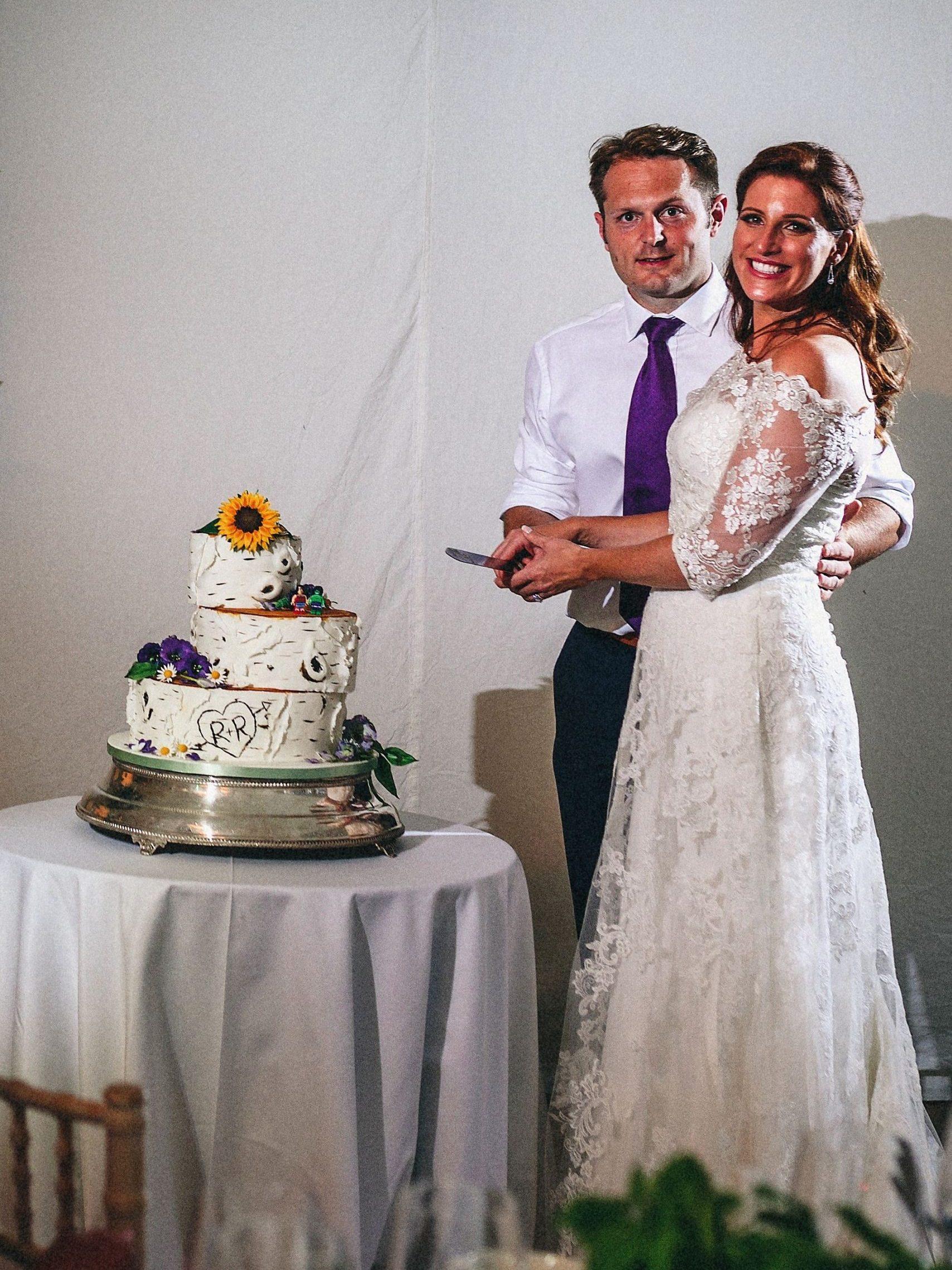 Cutting Wedding Cake London Wedding Fulham Palace silver birch wedding cake