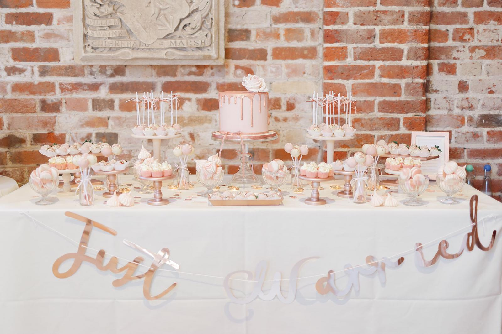 pink rose gold wedding dessert table gaynes park essex wedding macarons cake pops mini cupcakes meringue kisses chocolate strawberries