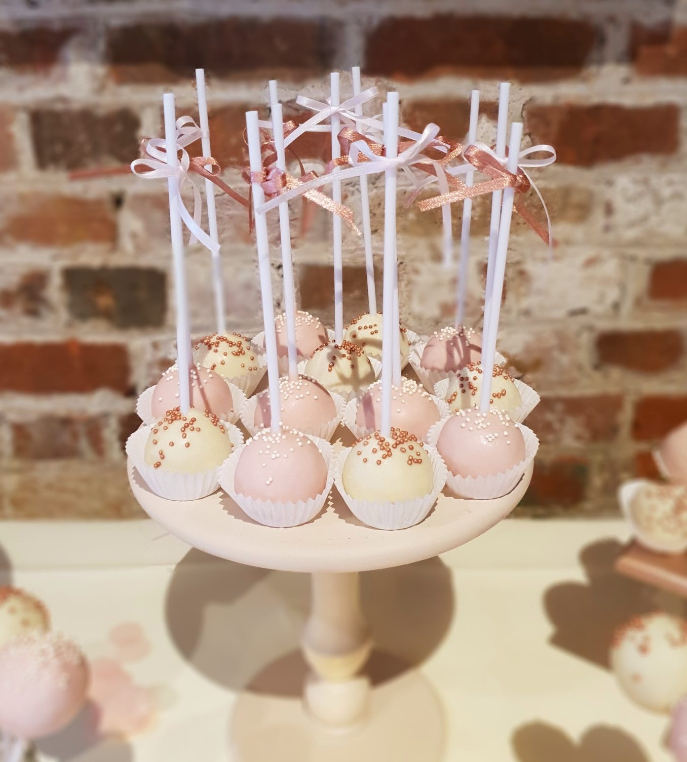 White pink rose gold cake pops luxury dessert table gaynes park essex wedding