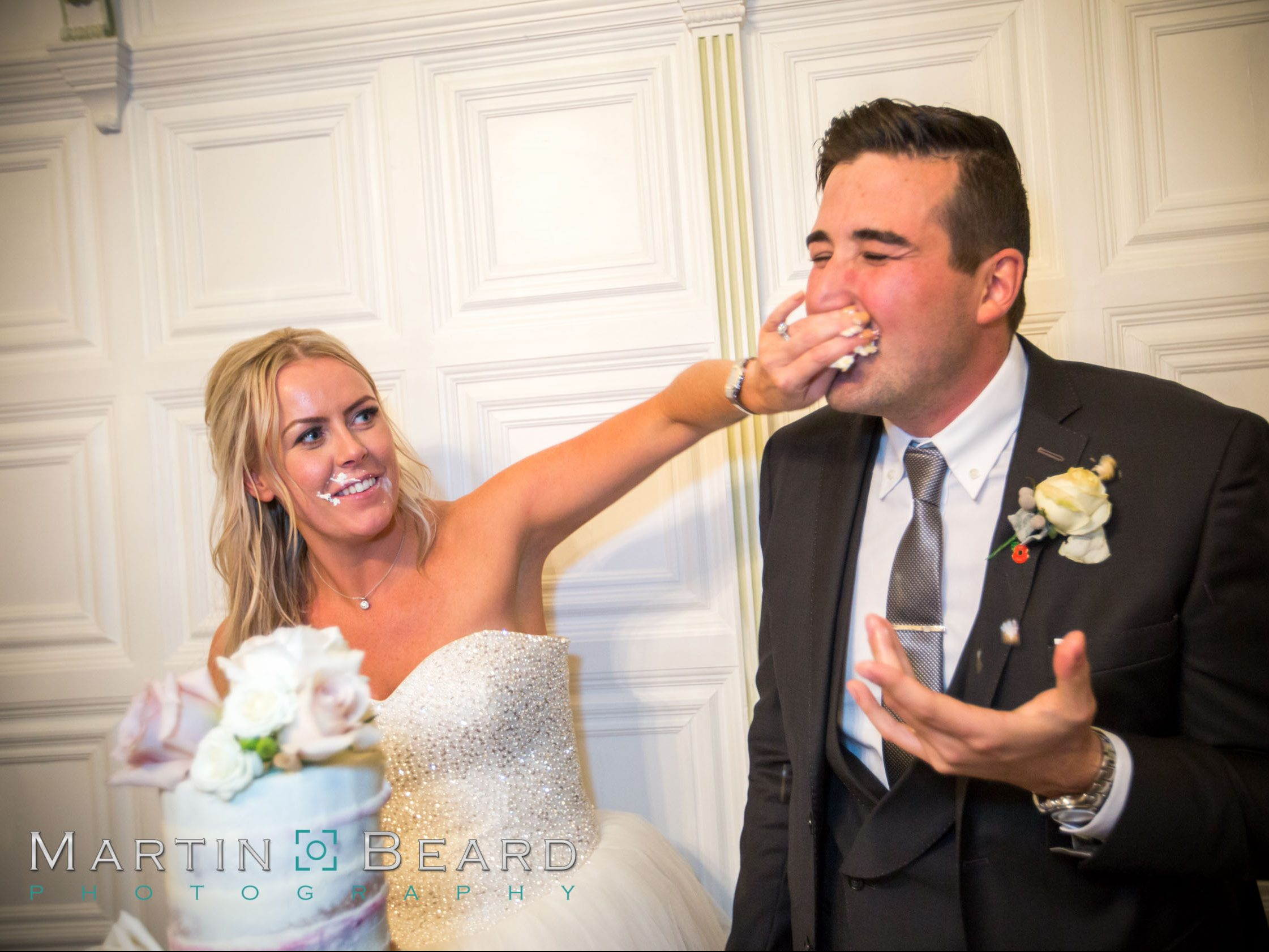 Cutting the cake, smashing it in her face, naked wedding cake at hengrave hall suffolk
