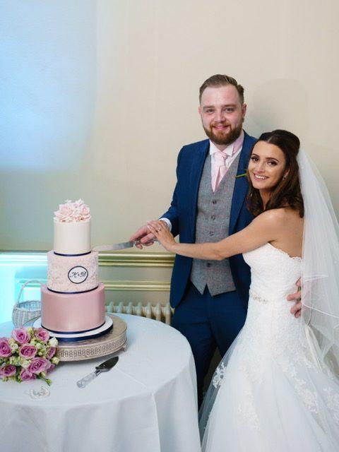 cutting the wedding cake pink navy wedding cake that amazing place harlow essex wedding